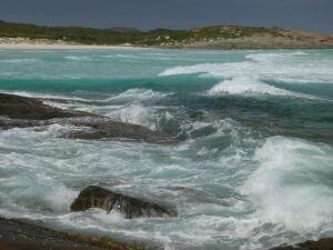Orleans Bay Caravan Park - 3rd Beach shore stones and surf