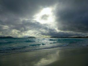 Orleans Bay Caravan Park - Big Wharton clouds at beach